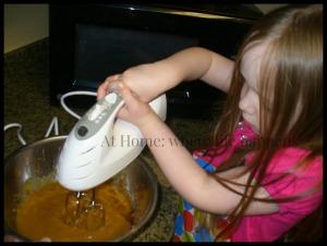 mixing pumpkin donuts