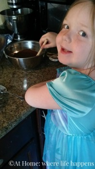 making donuts stirring batter