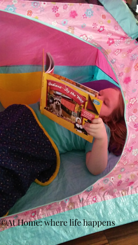 reading in the tent