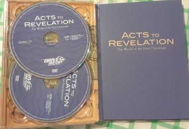 The inside cover of the study guide with two of the discs. The third is on the back cover of the guide.