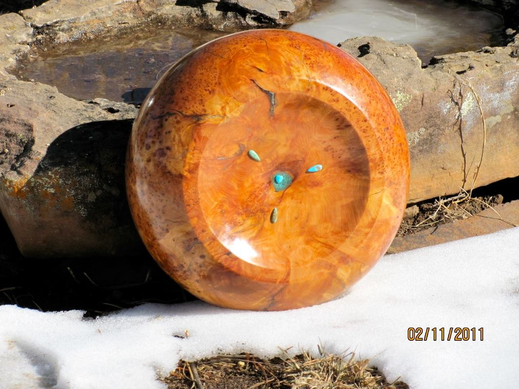 Speaking Wood image of turquoise on a bowl